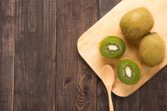 Fresh Kiwis Fruit And Spoon On Wooden Board. Royalty Free Stock Image