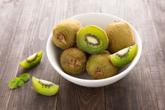 Fresh kiwis fruit on brown wooden background.  stock photography