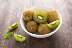 Fresh kiwis fruit on brown wooden background Stock Photography