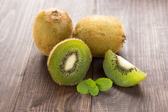 Fresh kiwis fruit on brown wooden background. Fresh kiwis fruit on brown wooden background royalty free stock photography