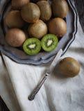 Fresh kiwis on vintage plate. Stock Images