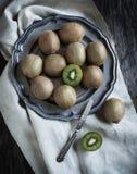 Fresh kiwis on vintage plate. Stock Photo
