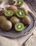 Fresh kiwis on vintage plate. Stock Image