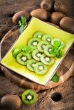 Fresh kiwis on wooden background close up. royalty free stock photos