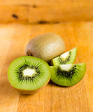 Fresh kiwis on wooden ground Royalty Free Stock Photos