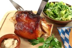 Fresh knuckle of pork with cutlery Stock Images