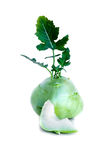 Fresh kohlrabi with a bited piece and green leaves on isolated white backround.  Stock Photo