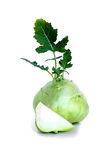Fresh kohlrabi with a cuted piece and green leaves on isolated white backround.  Stock Photos