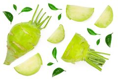Fresh kohlrabi with green leaves isolated on white backround. Top view. Flat lay.  stock illustration