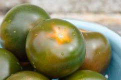Fresh kumato tomatoes Royalty Free Stock Image
