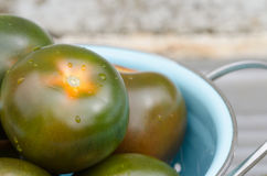 Fresh kumato tomatoes Royalty Free Stock Photography