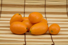 Fresh kumquat against a mat Stock Photo