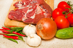 Fresh lamb meat and vegetables. Stock Photos