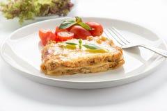 Fresh lasagna with basil on white background Royalty Free Stock Image