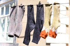 Fresh laundry socks hanging on a clothesline.  Royalty Free Stock Photo