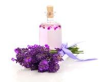 Fresh lavender blossoms with Natural handmade lavender oil. On white background stock image