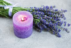 Fresh lavender flowers and candle. On a concrete background royalty free stock images