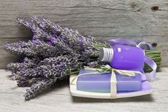 Fresh lavender, gel and soap. Lavender and some hygiene items made of lavender on an old wooden shelf Royalty Free Stock Photos