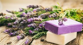Fresh lavender and lavender soaps. Fresh lavender bunch and lavender soaps on wooden background stock photos