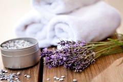 Fresh lavender white towel and bath salt on wooden background stock photo