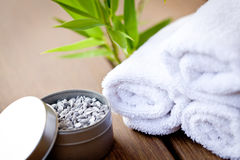 Fresh lavender white towel and bath salt on wooden background Stock Photography