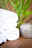 Fresh lavender white towel and bath salt on wooden background Royalty Free Stock Photography