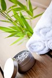 Fresh lavender white towel and bath salt on wooden background Royalty Free Stock Photos