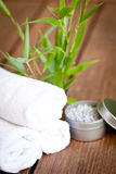 Fresh lavender white towel and bath salt on wooden background Stock Photos