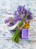 Fresh lavender on wood. Lavender bunch with oil and soap on white wood. Shot from upper view Royalty Free Stock Photos