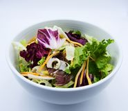 Fresh leaf salad in bowl on white background stock photo