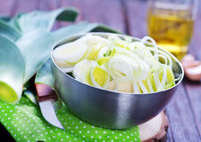 Fresh leek. In metal bowl and on a table Stock Photography