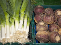 Fresh leeks and swedes ready for sale Stock Photo