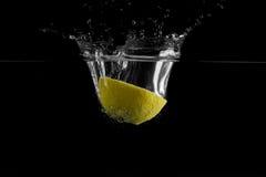 Fresh lemon. Falling into water stock photos