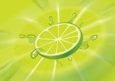 Fresh lemon. A green lime slice splashed Royalty Free Stock Image