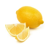 Fresh lemon. One lemon and two slices are isolated Stock Image