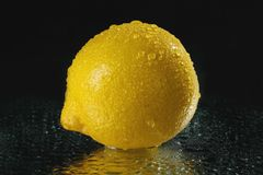 Fresh lemon. With drops of water royalty free stock photography