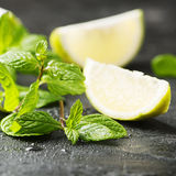 Fresh lemon anf green mint on the black table Royalty Free Stock Photography