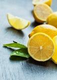 Fresh lemon on black stone Royalty Free Stock Image