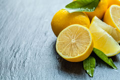 Fresh lemon on black stone Stock Images