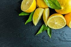 Fresh lemon on black stone Stock Photography