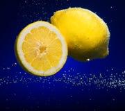 Fresh lemon with bubbles Stock Photos