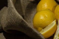 Fresh lemon on a burlap cloth . Stock Image