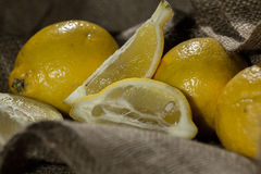 Fresh lemon on a burlap cloth . Royalty Free Stock Photos