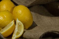 Fresh lemon on a burlap cloth . Royalty Free Stock Photography