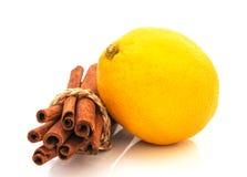 Fresh  lemon  with  cinnamon  isolated on white background Royalty Free Stock Photography
