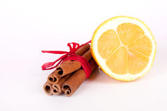 Fresh lemon and cinnamon sticks Royalty Free Stock Images
