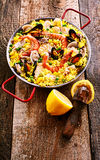 Fresh Lemon and Colorful Seafood Paella Rice Dish Stock Photo