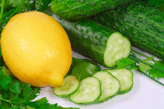 Fresh lemon, cucumbers and greens Stock Images