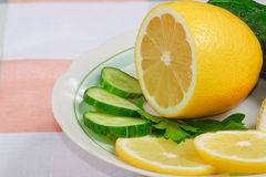 The fresh lemon, cucumbers and parsley. Leaf Royalty Free Stock Photography