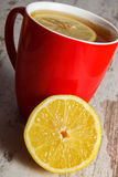 Fresh lemon and cup of hot tea on wooden table, healthy nutrition Stock Photo